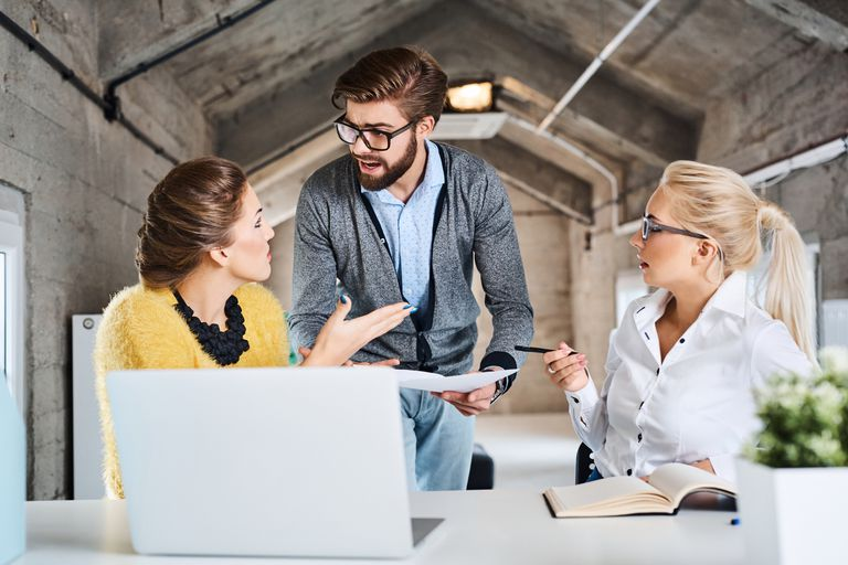 Three business people disagreeing