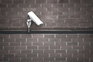 Security camera on brick wall