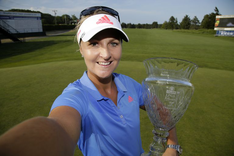Anna Nordqvist of Sweden imitates taking a selfie with the championship trophy after winning the ShopRite LPGA Classic presented by Acer on the Bay Course at the Stockton Seaview Hotel & Golf Club on May 31, 2015 in Galloway, New Jersey
