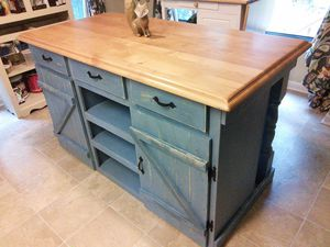 A distressed farmhouse style kitchen island.