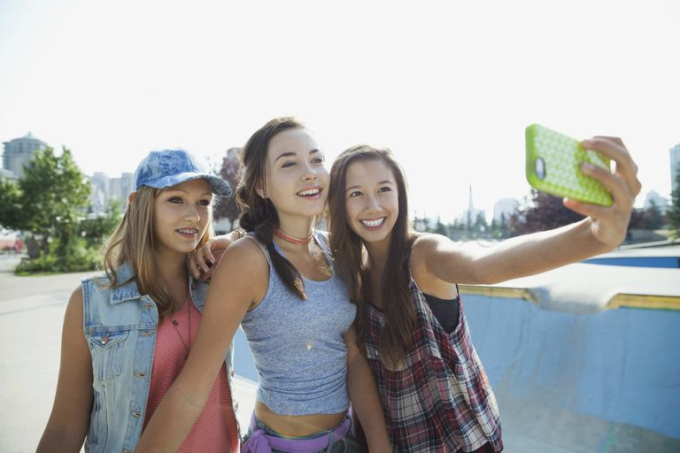 Three teen girls take a selfie