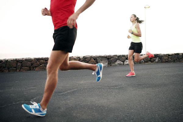 Man and girl jogging at evening