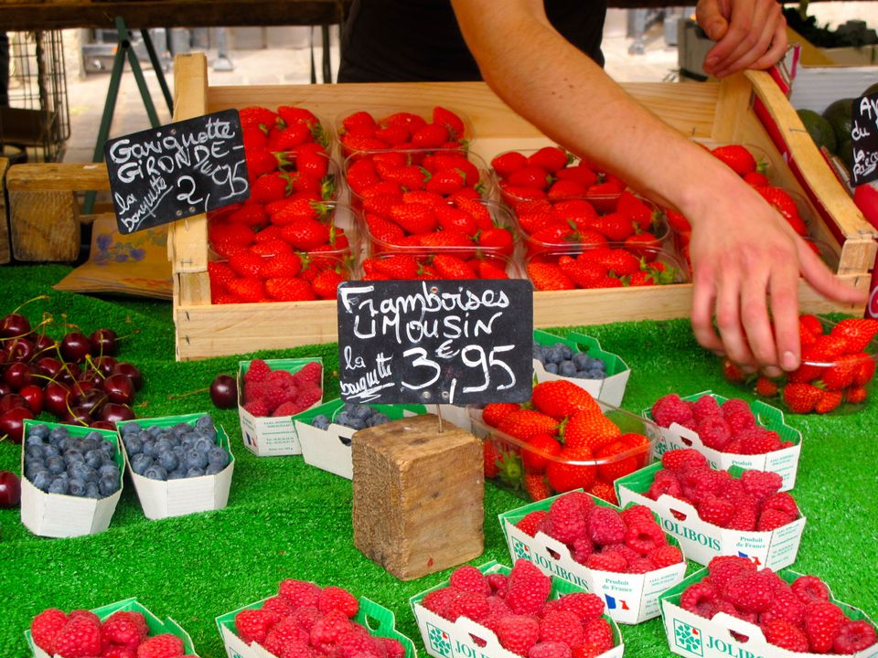 Fresh red fruits and berries at the Aligre food market in Paris.