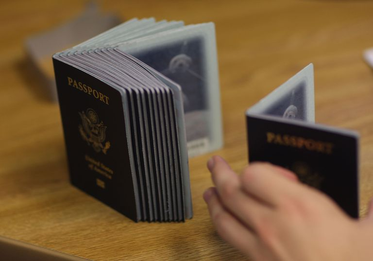 Person processing a stack of new US Passports