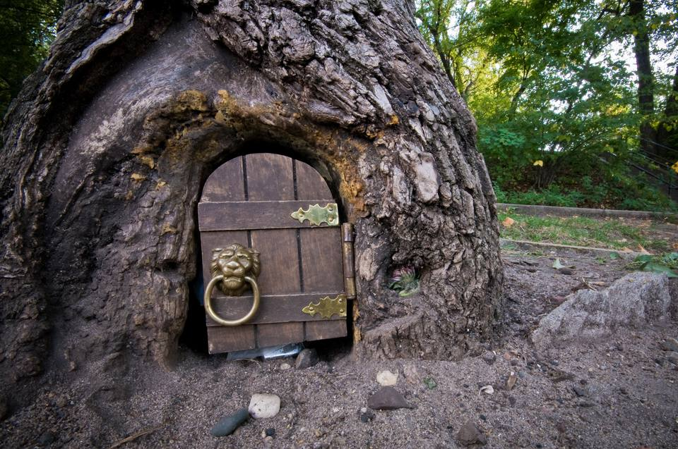 A tiny door in the side of a tree where mail is left for the 'elf' at Lake Harriet.