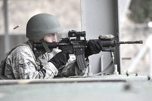 Airman 1st Class Charles Manarino zeroes in his weapon before a shooting exercise March 7, 2013, at the Jinjui Air Force Education and Training Command firing range, South Korea. The air police special-duty team course aims to train American and Korean airmen in tactics for base defense. Manarino is a 51st Security Forces Squadron member.