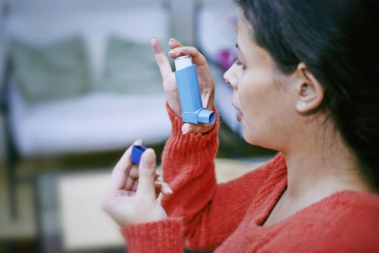 Woman using a bronchodilator