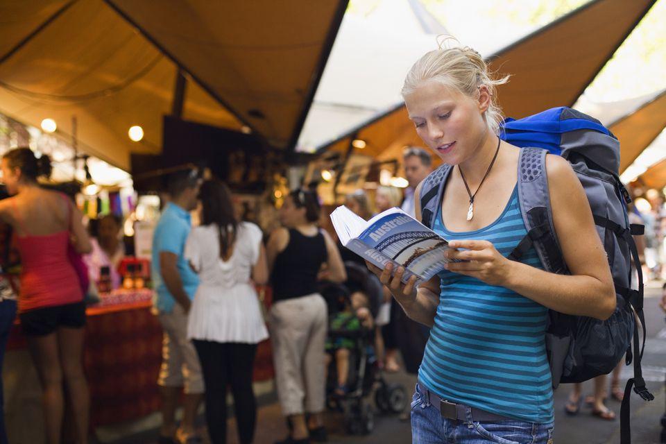 Backpacker and guidebook.jpg