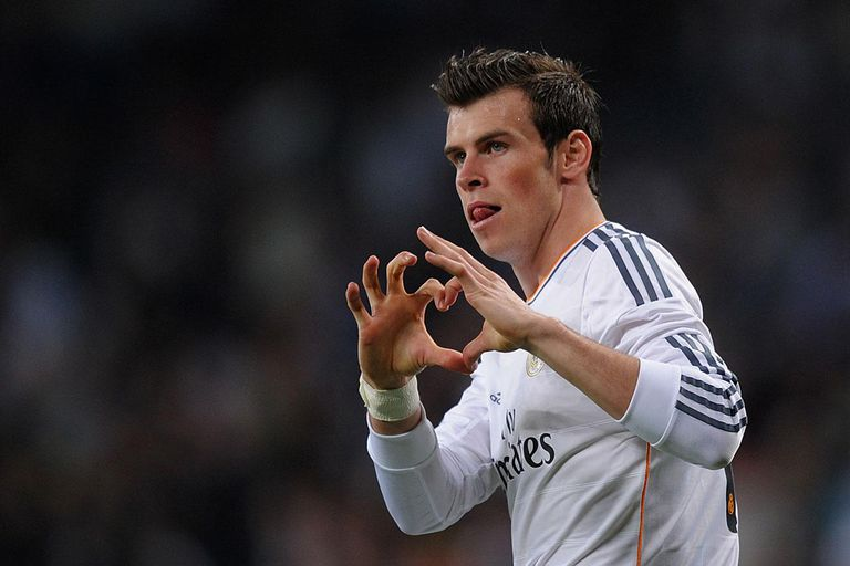 MADRID, SPAIN - APRIL 12: Gareth Bale of Real Madrid celebrates after scoring Real's 2nd goal during the La Liga match between Real Madrid and Almeria at Santiago Bernabeu stadium on April 12, 2014 in Madrid, Spain.