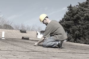 Home inspector checking the roof of a house.