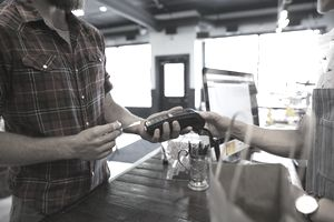 Man paying for purchase with credit card