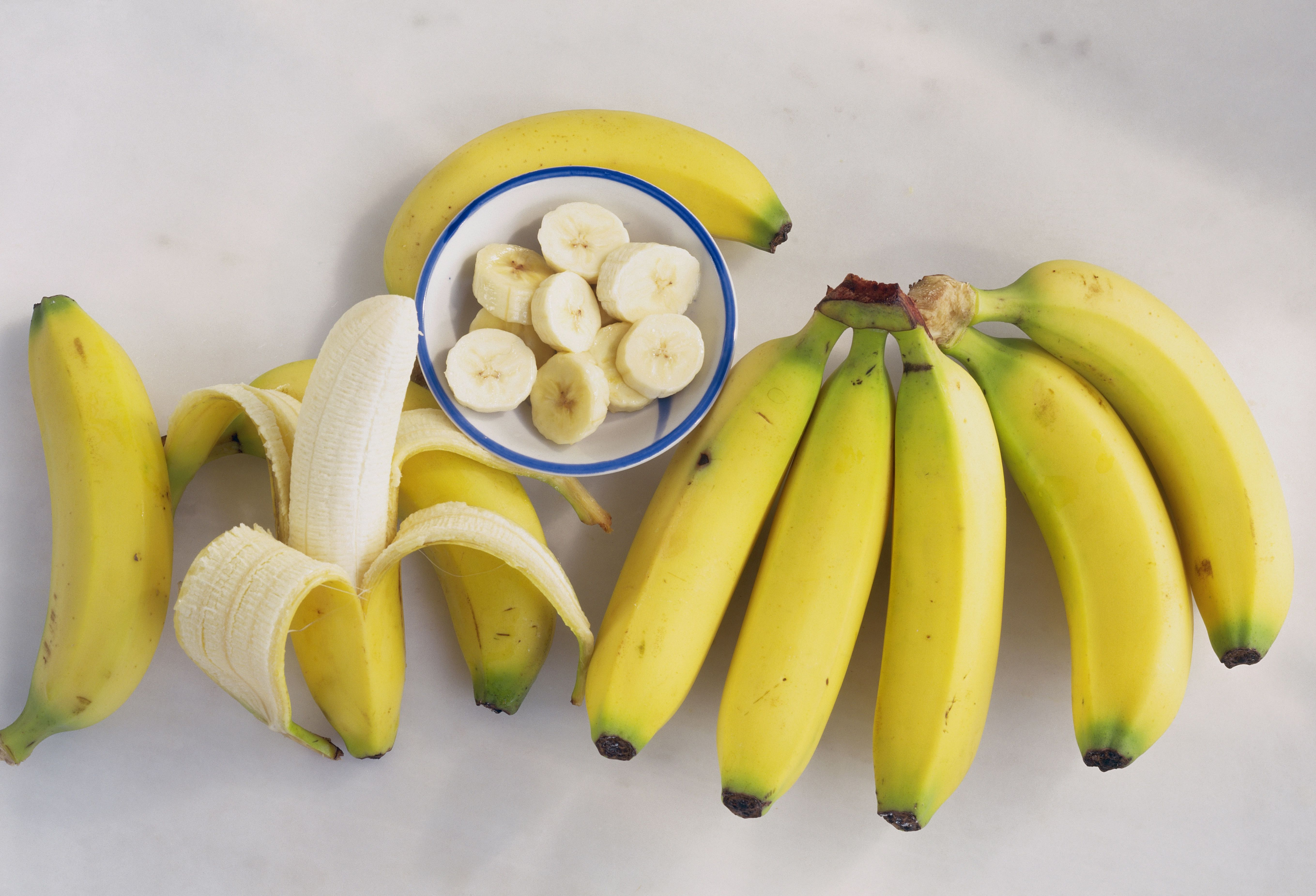 Peel the bananas and cut them into chunks before freezing. When you want ice cream, dump a couple handfuls into a food processor and whiz until they turn into creamy goodness.