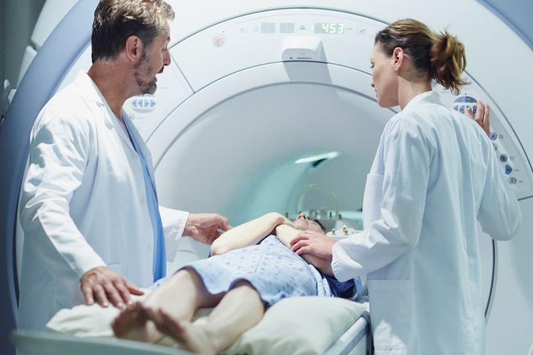A patient is loaded into an MRI machine.