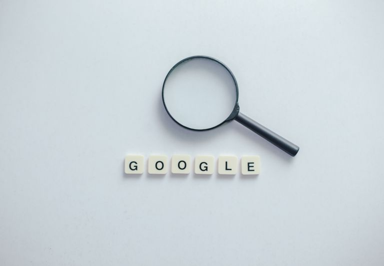 Magnifying Glass above Google