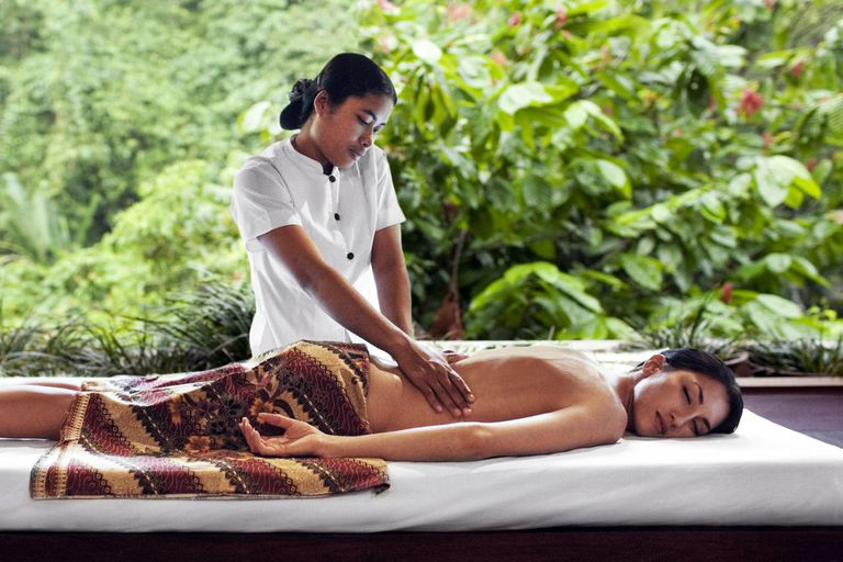 Young woman receiving a massage at Ayung Spa, Ubud Hanging Gardens, Bali, Indonesia.
