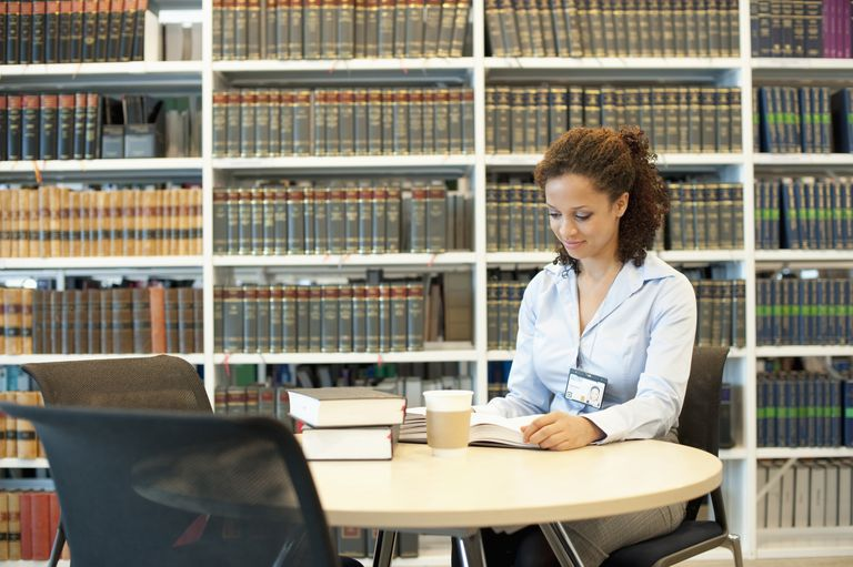 Single mom finding free legal aid at the library.