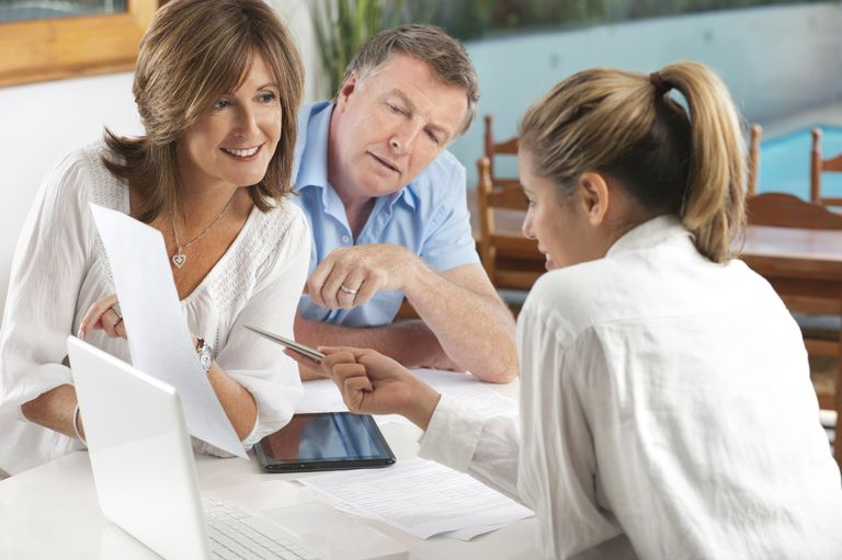Happy mature Couple in Meeting With Advisor