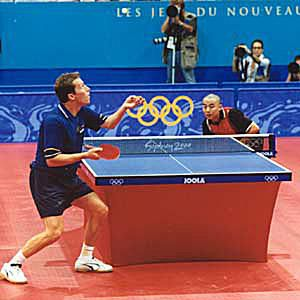 Photo of Jan-Ove Waldner and Liu Guoliang playing table tennis