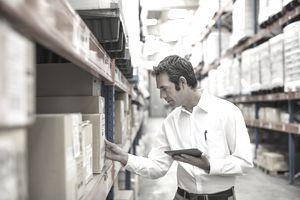 Warehouse supervisor examining merchandise