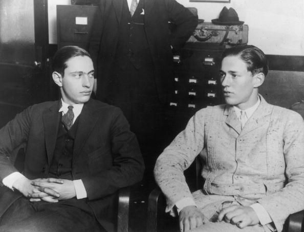 Murderers Nathan Leopold and Richard Loeb sitting in an office together.