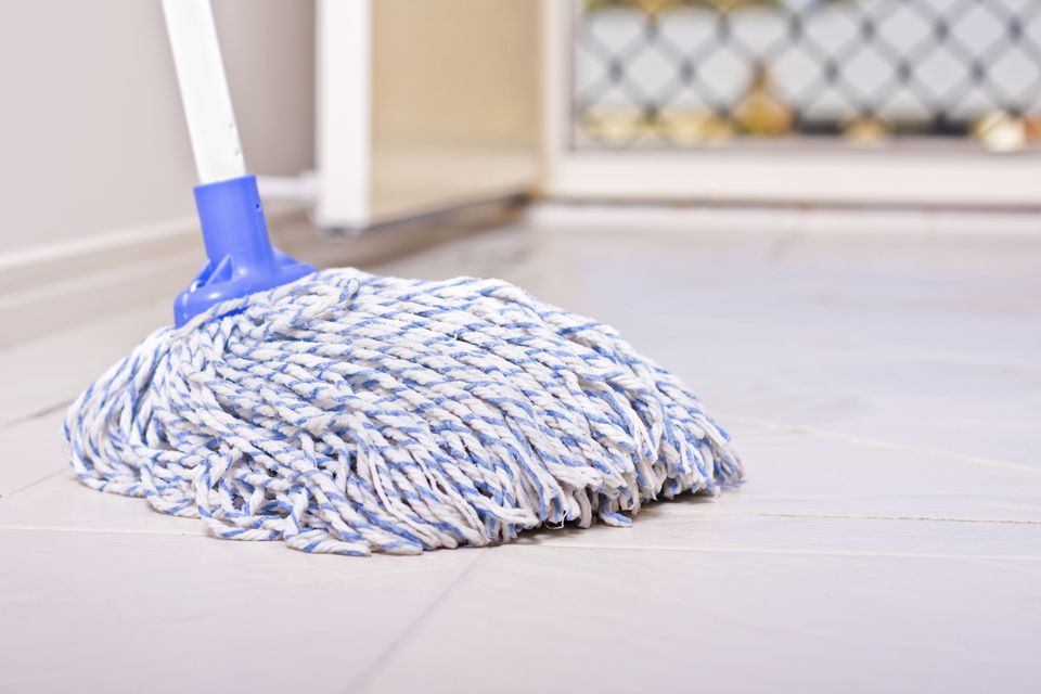 Mop On Tiled Floor With Copy Space