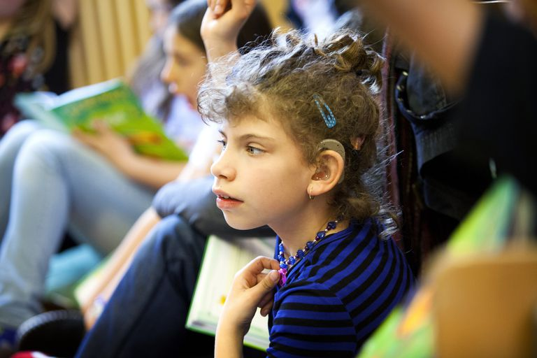 HEARING-IMPAIRED CHILD Reportage on Elsa, 10, who has been deaf from birth and wears bilateral cochlear implants. Her deafness was detected when she was 10 months old and she had implants for the first time when she was 17 months and then again at 3. She said her first word when she was 22 months old. She went to a school for the deaf, then she started at regular school when she was 5. Elsa in her Year 5 class.