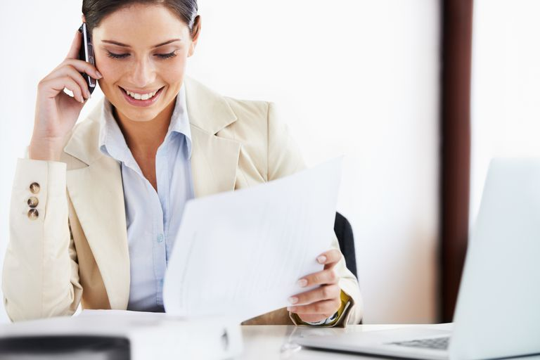 Woman doing paperwork.