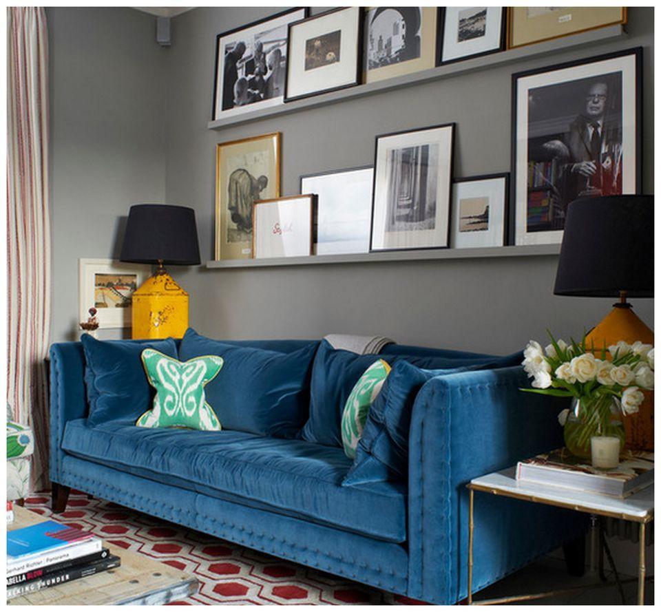 Shelves and art above a sofa
