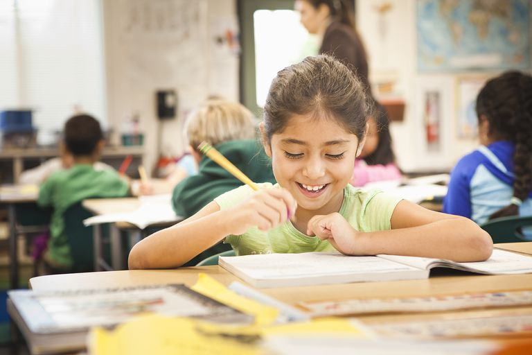 second grade - girl in classroom smiling