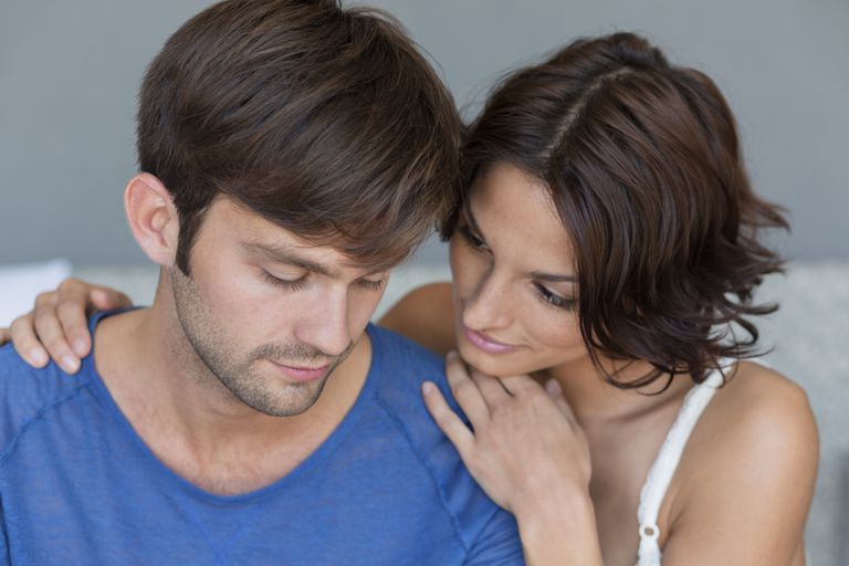 woman consoling man
