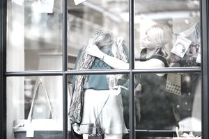 Woman designing front window of store