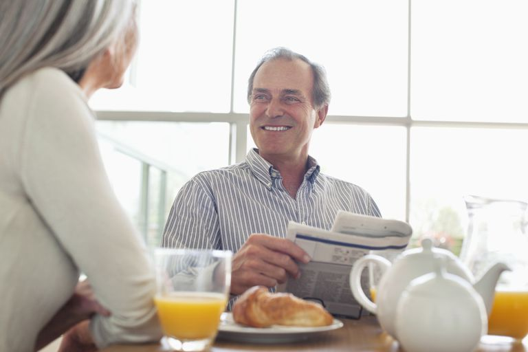 Smiling senior couple at breakfast table