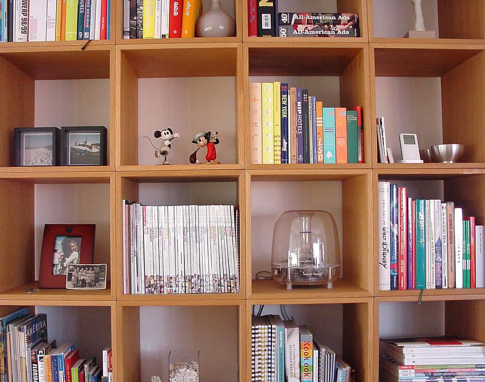 Books and stuff on a bookshelf.