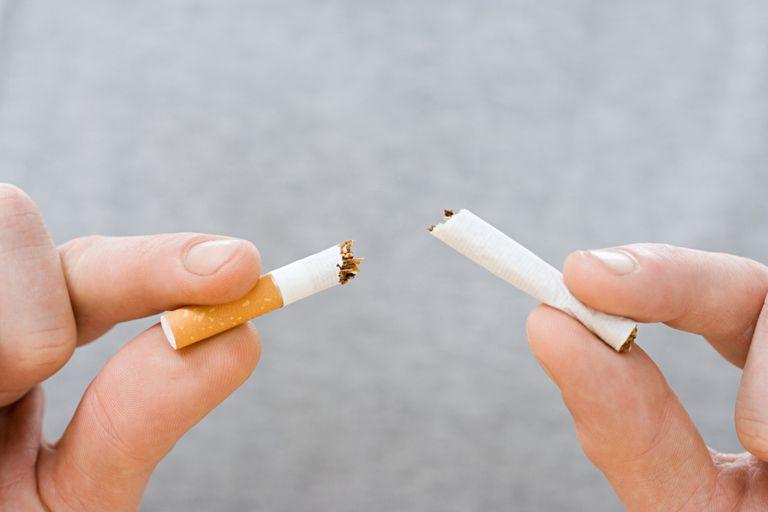 breaking cigarette in half