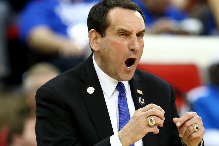 RALEIGH, NC - MARCH 21: Head coach Mike Krzyzewski of the Duke Blue Devils calls out in the second half against the Mercer Bears in the second round of the 2014 NCAA Men's Basketball Tournament at PNC Arena on March 21, 2014 in Raleigh, North Carolina.