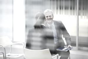 Smiling businessman talking to businesswoman