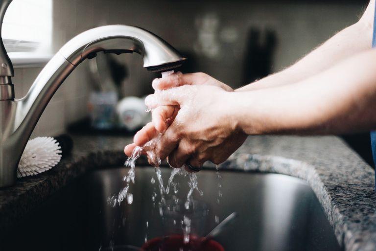 Man washing hands in sink