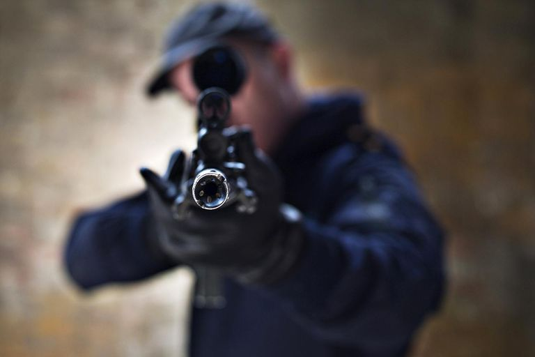Police officer aiming rifle