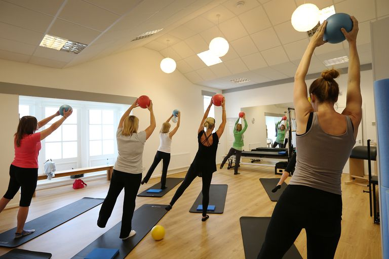 Women exercise during a Pilates class.