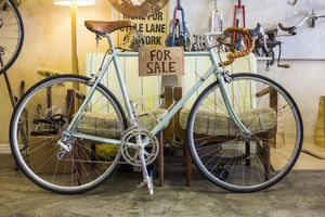 Vintage bicycle with 'for sale' sign