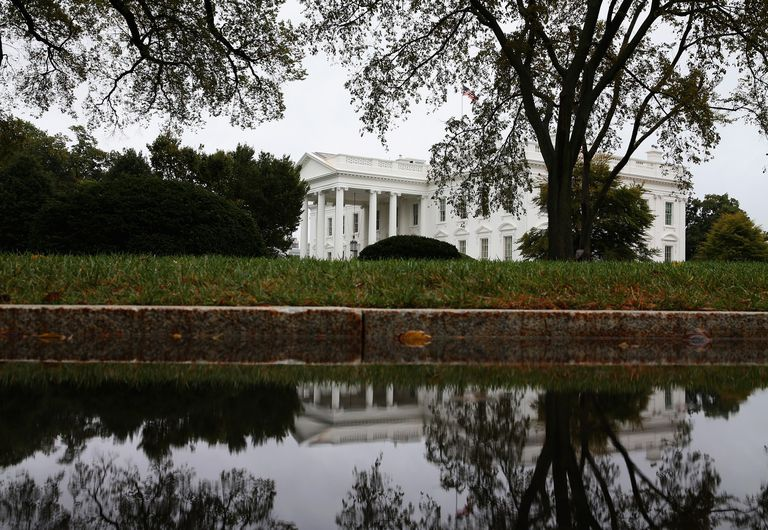 The White House's reflection on a driveway puddle