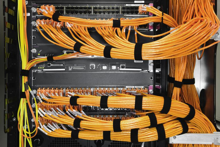 Detail of orange cables in a server room.