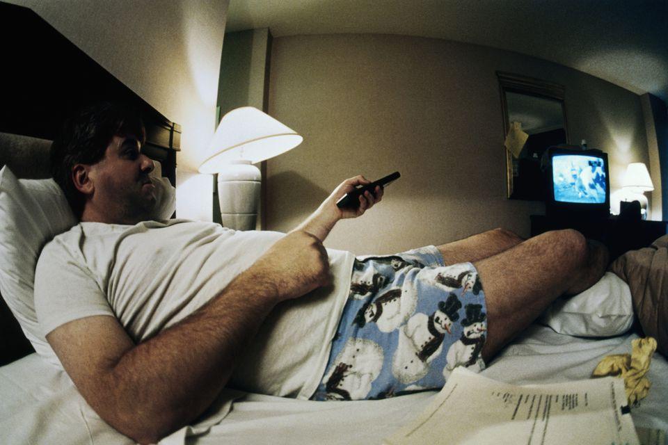 Man in underwear in hotel room