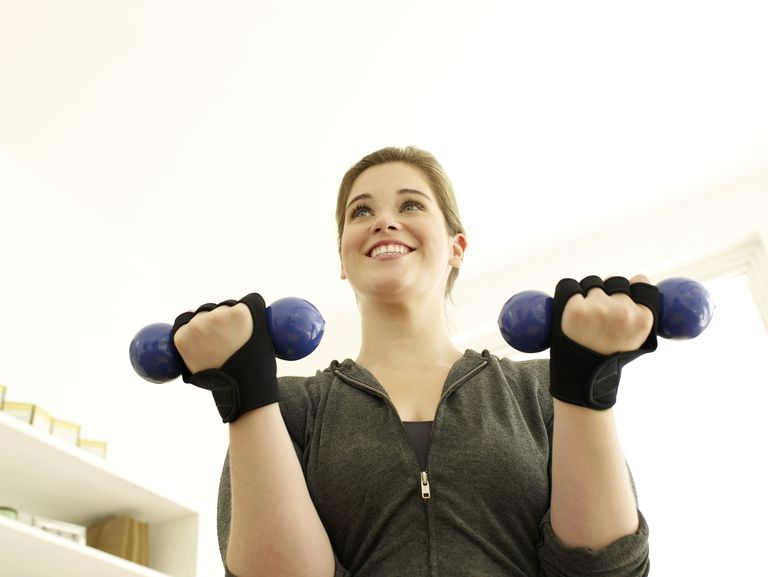 Young woman exercising in the house