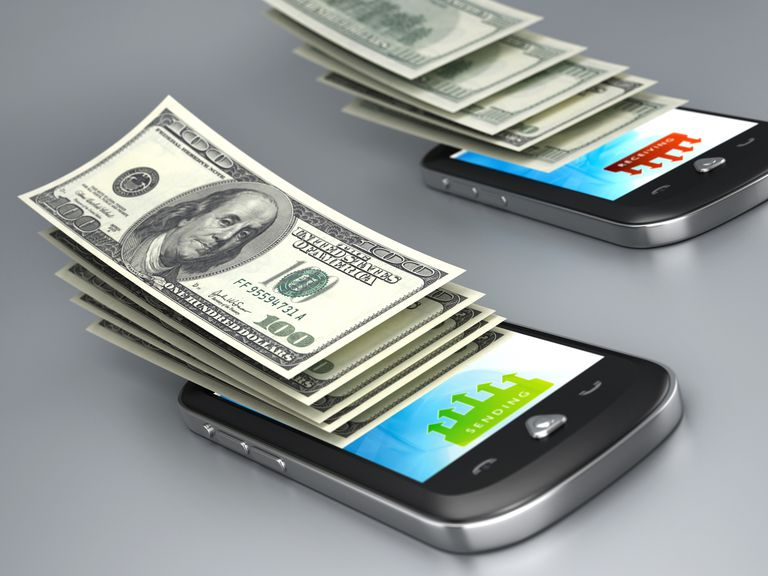 Two cell phones with one hundred dollar bills.