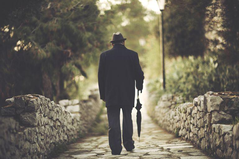 Senior man walking in a park