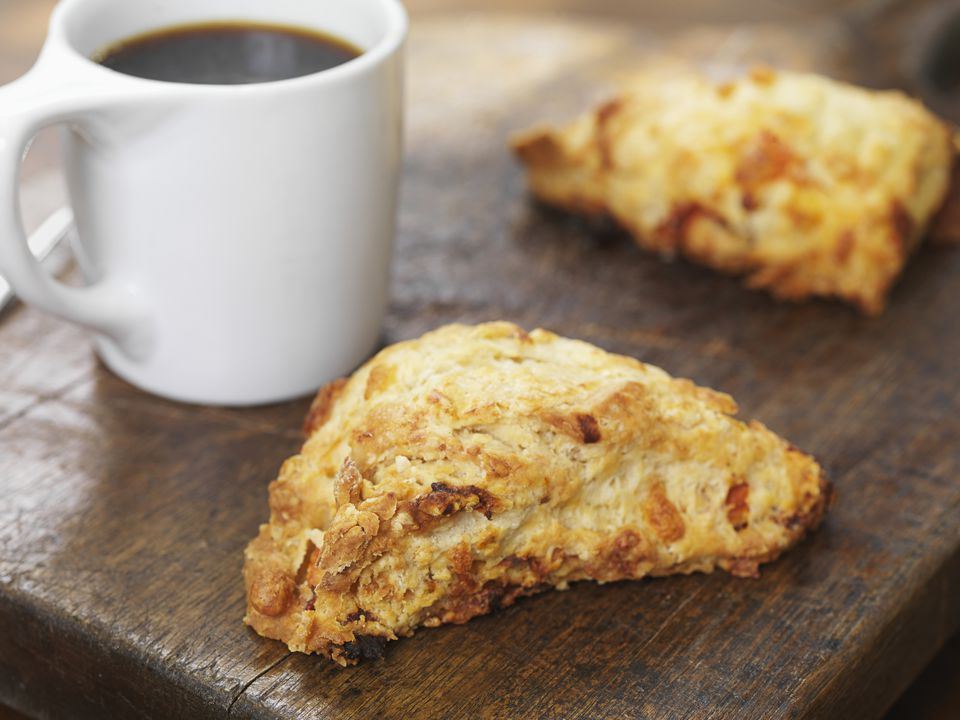 Pumpkin Spice Scones on Cutting Board with Cup of Coffee