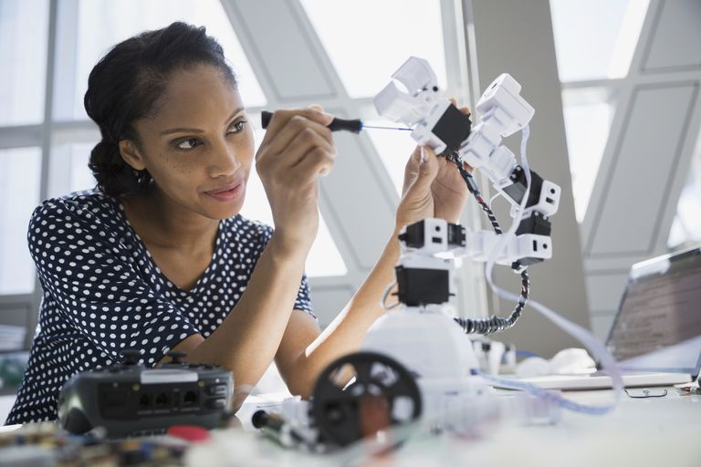 Engineer working on robotic arm