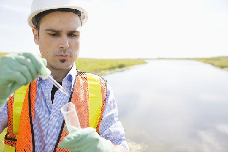 Hydrologist takes a water sample