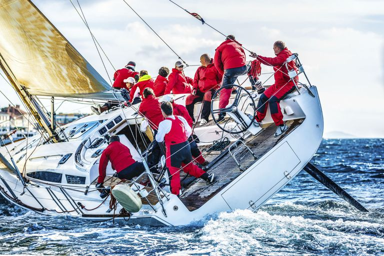 Crew sailing a boat in a race